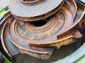 Traces of cavitation and corrosion damage on pump